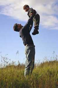 Father and son in field