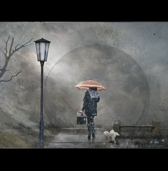 Woman walking in snowstorm with cat and dog